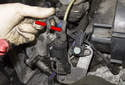 Secondary air solenoid replacing: To replace the secondary air solenoid, start by removing the vacuum hoses (red arrows).