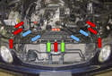 Working at the top of the radiator support, remove the four plastic rivets (blue arrows), seven 10mm fasteners (red arrows) and the two T30 Torx fasteners (green arrows).