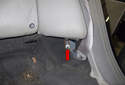 Rear Seat: Working at the side backrest cushion, remove the 10mm fastener (red arrow).