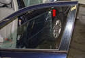 Pull the door glass out of the rear corner of the door first, moving it up and sliding it out of the door.