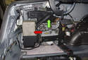 The pump (red arrow) and reservoir (green arrow) are located in the left side trunk (fender) area.