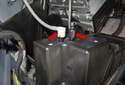 Working at the lines (red arrows), remove them from the pump by pulling them straight off.