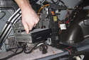 Once the fastener is removed, swing the CD changer mount out and away from the fender.
