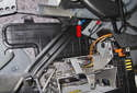 Working below the trunk arm spring, remove the 10mm support fastener (red arrow).