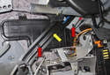 Working above the support arm and body panel, remove the T25 Torx fasteners (red arrows).