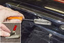 License Plate Bulbs and Lens: Using a small flathead screwdriver, lever the lens out of the trunk to remove it.