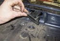 License Plate Bulbs and Lens: Remove it from the trunk while feeding the wiring harness out.