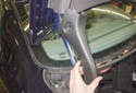 Third Brake Light: Remove the trunk support trim by sliding it up and off the trunk support.