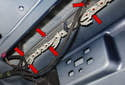 Third Brake Light: To replace or remove the lens, press in and hold the retaining tabs (red arrows).