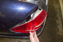 Then pull the taillight out of the fender to remove it.