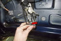 Then, pull the handle (working inside the trunk lid) out just enough to access the electrical connector.