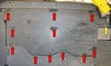 The side trays are held in place by a series of plastic 10mm nuts (red arrows).