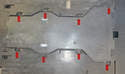 The center tunnel tray is held in place by plastic 10mm nuts (red arrows).