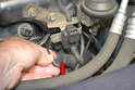 Carefully pull the vacuum line of the bottom of the actuator (red arrow).