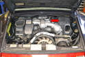 Whether you have an OBD1 engine, Varioram, Tiptronic or standard transmission the airbox is on the right side of the engine (red arrow).
