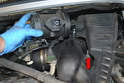 Lift the airbox up and off the spud that it sits on (red arrow) and move it slightly to the right.