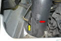 Begin by carefully removing the hose attached to the nipple on the heat tube by wiggling it straight off (red arrow) and then pull off the two electrical connections (yellow arrow).
