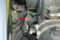 Separate the electrical connection on the left side of the blower (red arrow).