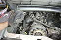Pull the blower slightly forward and then remove it from the engine compartment.