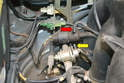 Separate the vacuum line (red arrow) from the nipple on the regulator (yellow arrow).