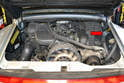 Whether you have a non-Varioram, Varioram, Carrera, C4S or any other 993 the fuel filter is located in the right side of the engine compartment (red arrow).