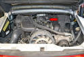 The injectors and fuel rail on the right side of the motor for bank 4-6 are located below the air box (red arrow) and you will need to remove this to replace the injectors.