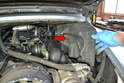 The power steering reservoir is located inside the engine compartment on the right side.