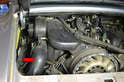 On the non-Varioram engines the blower motor assembly is located on the left side of the engine and you will need to remove the heat tube (red arrow) to remove the distributor caps.