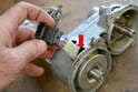 Separate the wiring from the mount and slide the wiring back into the distributor body so you can remove the shaft.