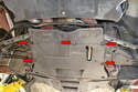 The transmission protection panel is also removed by using a Philips screwdriver and loosening the five screws (red arrows).