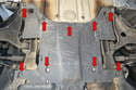To remove the forward panel that protects the steering and brakes you will again need a 10mm socket as it is held in place by a series of 10mm plastic nuts and metal bolts (red arrows).