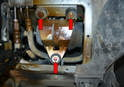 The pump is covered in a rubber sound deadening protector and is mounted to the bracket with a large hose clamp.