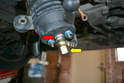 While supporting the 17mm nut on the base of the filter use a 19mm wrench and loosen the capping nut holding the banjo bolt on (yellow arrow).