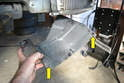Slip the tray off the bottom of the cooler by pulling it out from the two rubber grommets it sits in.
