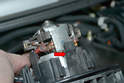 This phot illustrates the plastic clips that hold the motor and fan in place (red arrow).