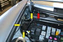 With the weather stripping off the firewall (red arrow) use a Philips head screwdriver and remove the three screws (yellow arrows) and remove the corner plate between the control panel housing and fender.