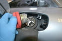 Open the fuel filler cap to help break the vacuum seal in the tank.