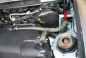 Disconnect the fill and vent lines by the fuel filler area (red arrow) using a 7mm socket.