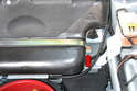 Use a 13mm socket and remove the hold down bolt on the fuel tank strap (red arrow).