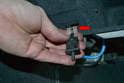 Carefully pull the wire connections off the contact switch by pulling the plastic connector (red arrow) do not pull them off by the wires.