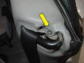 Remove the small Phillips head screw at the top of the side panel near the seat belt hole (yellow arrow).