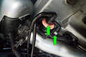 Next, disconnect the top two gas vapor lines (green arrows) on the fuel vent valve by squeezing the tabs on each line.