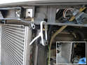 Tie the upper end of each radiator to the plastic bracket above it as a way to hold the radiator while removing the rear metal frame.