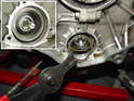 For engines with the single-row bearing, the bearing is held in place against the intermediate shaft by a big circlip.