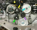 This photo shows the back of the engine and the three pulleys discussed in the text.