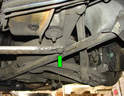 Remove the two 15mm bolts (green arrow) holding the aluminum crossmember piece between the suspension uprights and remove the crossmember.