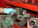 When the hub was removed from the wheel bearing carrier, the bearing split into two partsâ€