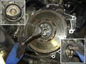 Attach your flywheel lock (see Photo 11) and constrain the flywheel in position as you remove the flywheel bolts.