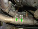 Now remove the three 13mm nuts holding each muffler to the exhaust brackets on the engine.