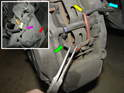 Grab the brake pad sensor (yellow and green arrow) with a pair of needle-nose pliers.